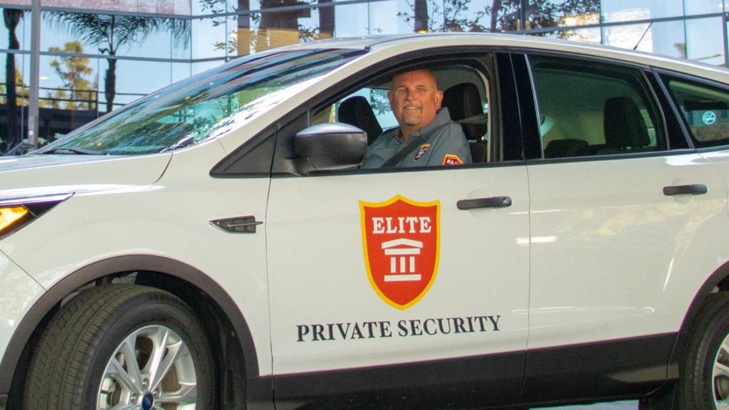 Security Patrol Guard at wheel of fleet vehicle